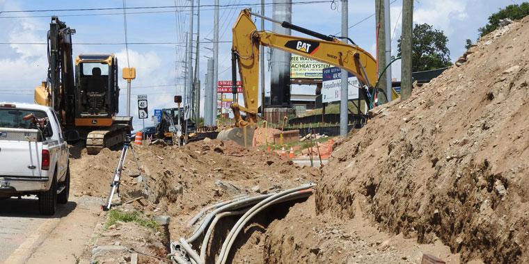BRI Utility Construction Sets up a Surveyors Level